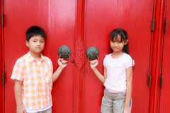 Boy girl and door Royalty Free Stock Images