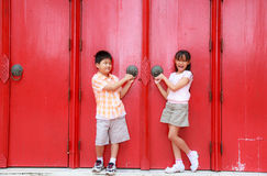 Boy girl and door Stock Images