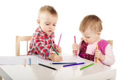 Boy and girl draw with pencils Stock Photo