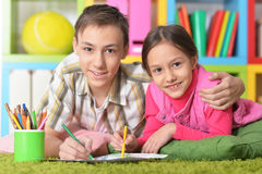Boy and a girl draw with pencils Royalty Free Stock Photos