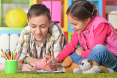Boy and a girl draw with pencils Stock Photo