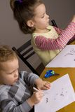 Boy and girl drawing Stock Photography