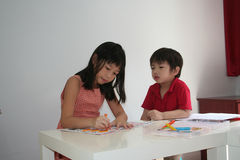 Boy & girl drawing. Boy & girl at art class Stock Photography