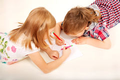 Boy and girl drawing heart. Love and valentine's day concept. Royalty Free Stock Photo
