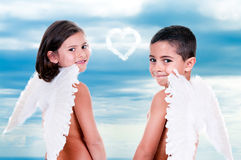 Boy and girl dressed as angels Royalty Free Stock Images