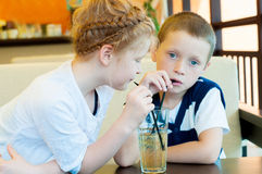 Boy and girl drink a drink Stock Image