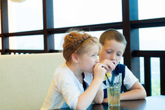Boy and girl drink a drink royalty free stock images