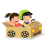 Boy and girl driving with cardboard car Royalty Free Stock Photography