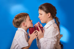 The boy and the girl drunk from a cup Royalty Free Stock Photography