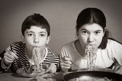 Boy and girl eat pasta Italian dinner funny close up photo