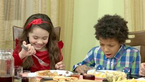 Boy and girl eating. stock video