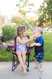 Boy and girl eating ice cream royalty free stock photo