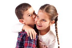Boy and girl in an embrace Stock Images