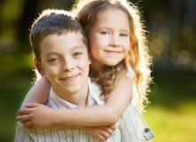 Boy and girl embracing Stock Photo