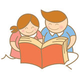 Boy and girl enjoy reading Stock Photo