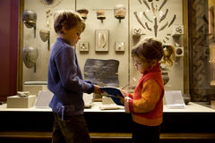 Boy and girl at excursion in historical museum Stock Photo