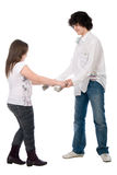 Boy and girl extort each other money Royalty Free Stock Image