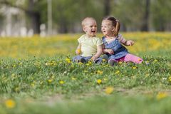 Boy and girl in the field Royalty Free Stock Image
