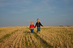 Boy and girl on the field stock photo