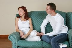Boy and girl fighting 018. A young couple sorting out their relationship on she couch stock image