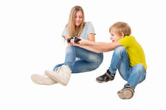 Boy and girl fighting over a joystick Royalty Free Stock Image