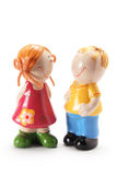 Boy and Girl Figurines. On White Background Stock Photography