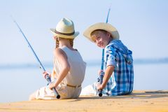 Boy and girl with fishing rods Royalty Free Stock Photos