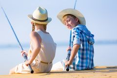 Boy and girl with fishing rods Royalty Free Stock Photography