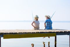 Boy and girl with fishing rods Stock Image