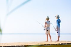 Boy and girl with fishing rods Stock Images