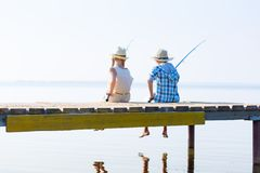 Boy and girl with fishing rods Stock Photography