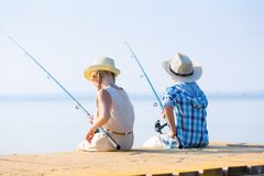 Boy and girl with fishing rods Royalty Free Stock Images