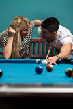Boy And Girl Flirting On A Pool Game Royalty Free Stock Image