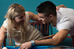 Boy And Girl Flirting On A Pool Game Stock Image