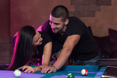 Boy And Girl Flirting On A Pool Game Stock Images