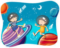 Boy and girl floating in the space Stock Photos