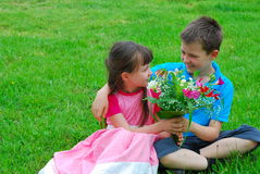 Boy and girl with flowers Royalty Free Stock Image