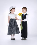 Boy and girl with flowers on date Royalty Free Stock Images