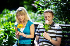 Boy and girl with flowers on a romantic date Stock Photo