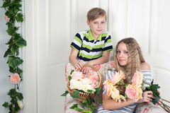 Boy and girl with flowers Stock Photo