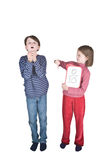 Boy Girl Flu Sneeze Elbow. A boy sneezes into his hands, and a girl makes a thumbs down sign because this is one of the ways that swine flu is spread. She is stock image