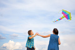 Boy and girl flying  kite Royalty Free Stock Images