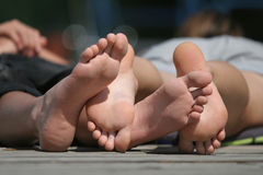 Boy and girl foots Stock Images