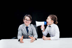 Boy and girl in formal wear interacting with bullhorn Royalty Free Stock Images