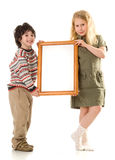 The boy and girl with a frame Stock Photo