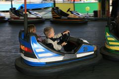Boy and a girl at the fun fair royalty free stock photography
