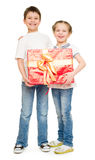 Boy and girl with gift box Stock Image