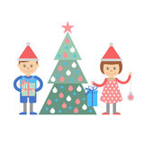 Boy and girl with gifts decorate Christmas tree. Stock Image