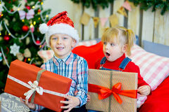 Boy and girl give Christmas gift Royalty Free Stock Image