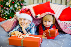 Boy and girl give Christmas gift Stock Photography